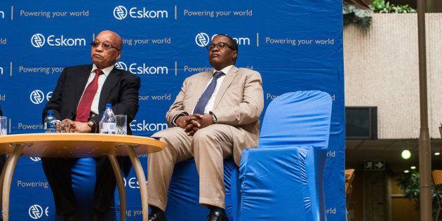 Jacob Zuma, South Africa's president, left, and Brian Molefe, chief executive officer of Eskom Holdings...