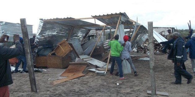 Residents of Siyahlala informal settlement tore down this shack because an immigrant was living in it...