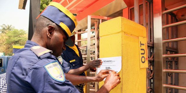 A local security staff member places a notice on the wall after anti-South African protesters attacked...
