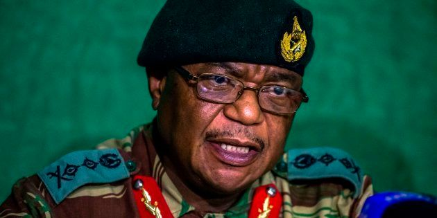 Zimbabwe's Commander Defense Forces General Constatntino Guveya Chiwenga (C) speaks during a press conference...