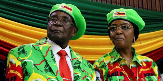 Zimbabwean President Robert Mugabe and his wife Grace attend a meeting of his ruling ZANU PF party's...