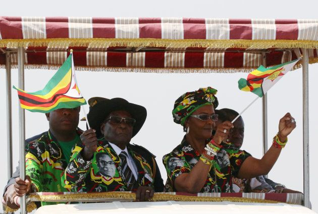 President Robert Mugabe and his wife Grace arrive for a rally in Gweru, Zimbabwe, September 1,