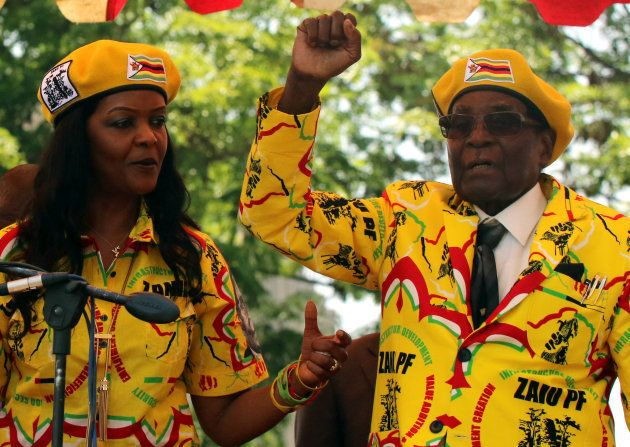 President Robert Mugabe and his wife Grace Mugabe attend a rally of his ruling ZANU-PF party in Harare,...
