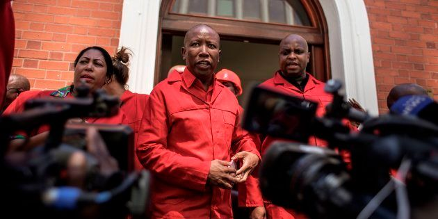 South African opposition party Economic Freedom Fighters (EFF) leader Julius Malema (C) talks to the...
