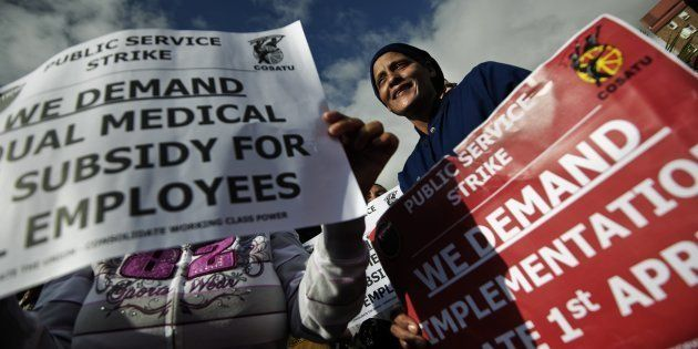 Several thousands of public workers march trough the streets of Cape Town central business district on...