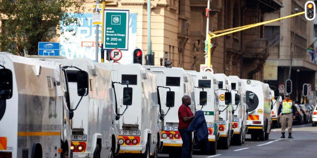 A cash-in-transit worker arrives to attend a nationwide protest following a spate of deadly heists this...
