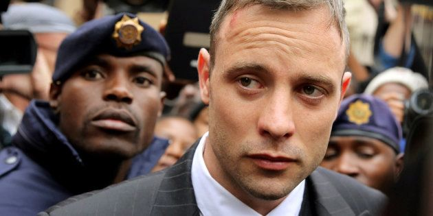 Olympic and Paralympic track star Oscar Pistorius leaves the North Gauteng High Court in Pretoria, South...