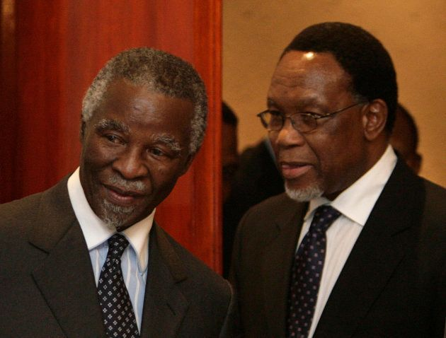 Former South African presidents Thabo Mbeki (L) and Kgalema