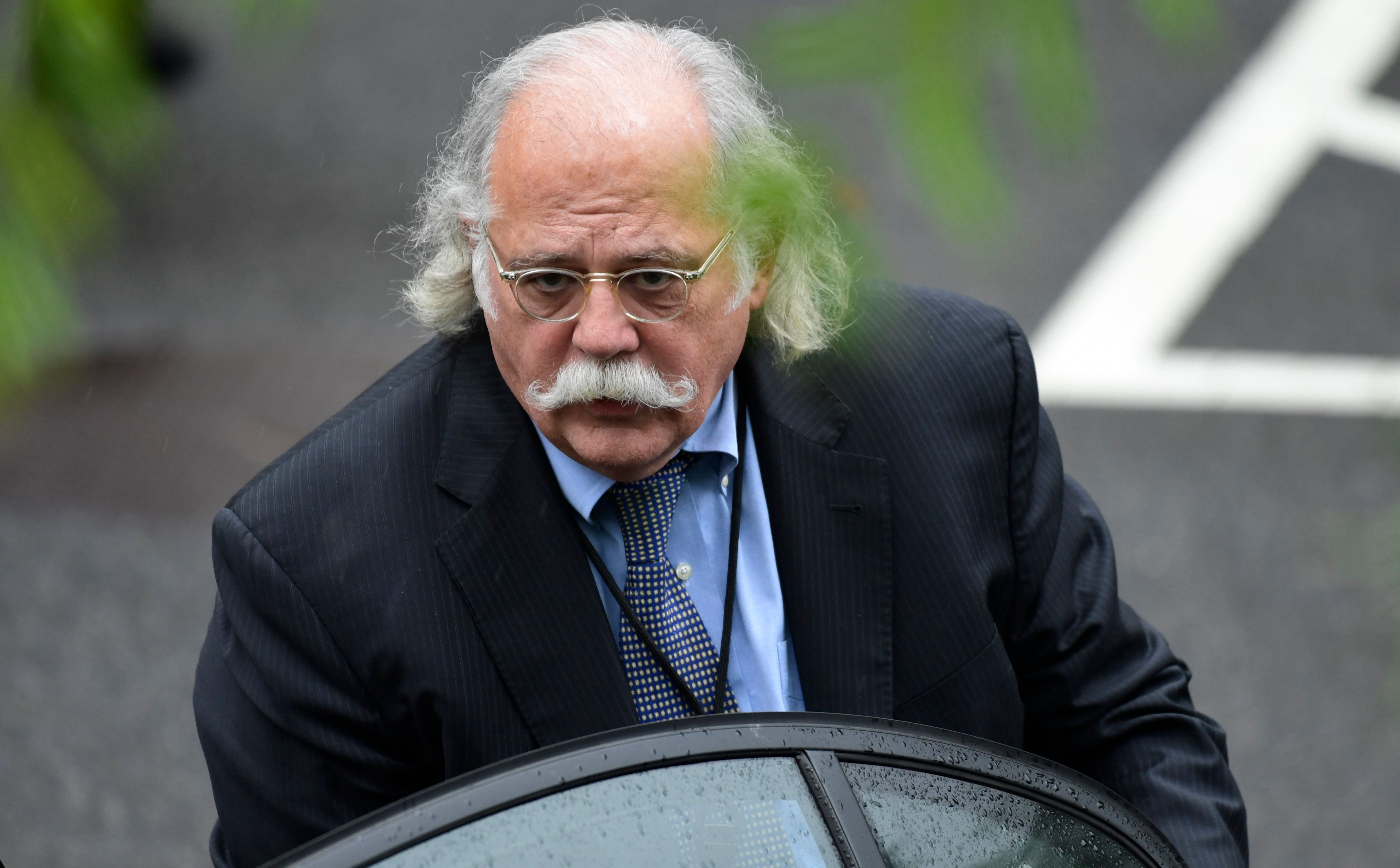 """FILE - In this May 17, 2018 file photo, White House lawyer Ty Cobb gets into his car at the White House in Washington. The former White House special counsel considers special prosecutor Robert Mueller """"an American hero.""""   Cobb tells ABC News' podcast """"The Investigation"""" he does not share President Donald Trump's opinion that Mueller's probe into Russian meddling in the election is """"a witch hunt.""""  Cobb says Mueller is a """"very justice-oriented person.""""   (AP Photo/Susan Walsh, File)"""