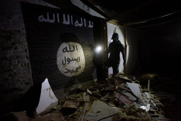 Islamic State slogans painted along the walls of the tunnel was used by Islamic State militants as an...