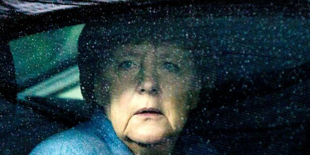 German Chancellor Angela Merkel waits in her car as she arrives to attend the Eastern Partnership summit...