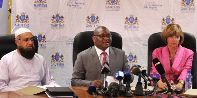 Gauteng Finance MEC Barbary Creecy, right, with Premier David Makhura, centre, and MEC for Roads and...