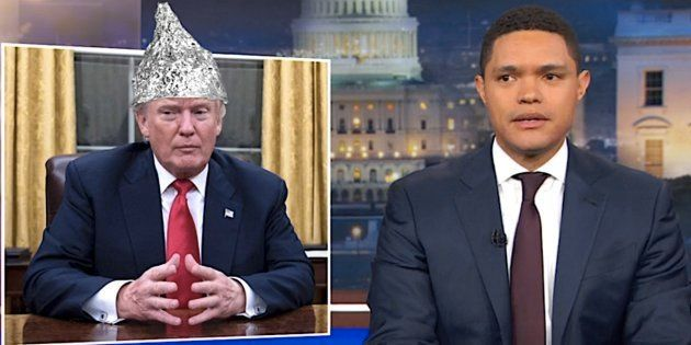 Trevor Noah, right, and his make-believe tinfoil-hatted