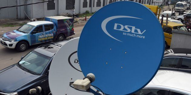 A picture shows broadcasting campany MultiChoice's digital satellite TV dishes installed on homes and