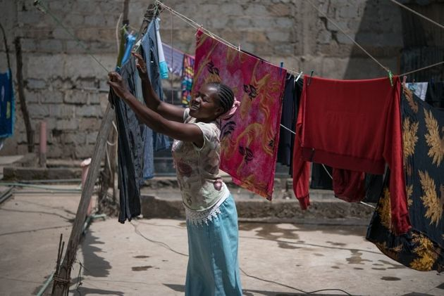 Tabitha Mwikali, 36, a domestic worker hanging clothes for her employer in Eastleigh, Nairobi,