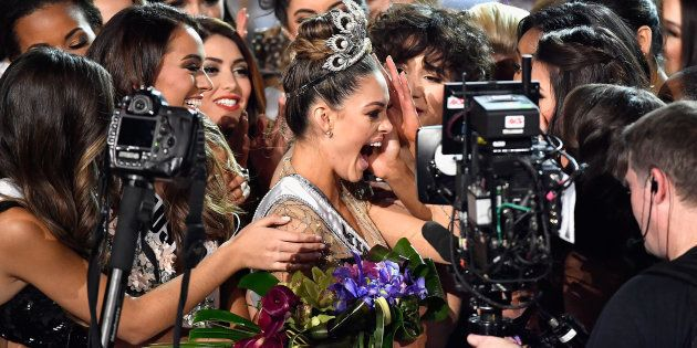 Miss South Africa 2017 Demi-Leigh Nel-Peters (C) reacts after being named the 2017 Miss Universe during...