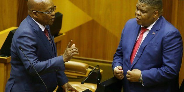 President Jacob Zuma shares a word with Energy Minister David Mahlobo in the National Assembly on November...
