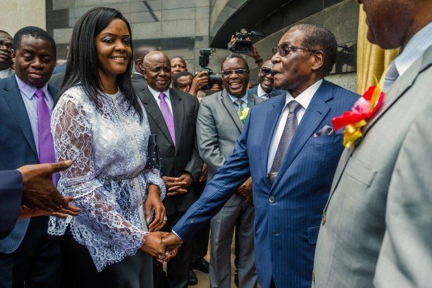 Zimbabwean President Robert Mugabe (R) is congratulated by First Lady Grace Mugabe after he unveiled...