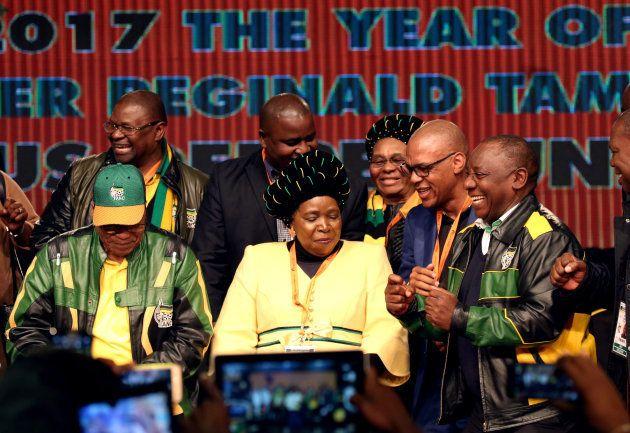 South Africa's President Jacob Zuma dances with former African Union chairperson Nkosazana Dlamini-Zuma...