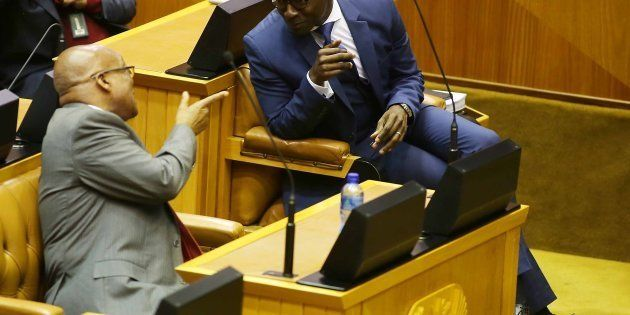 President Jacob Zuma shares a word with Finance Minister Malusi Gigaba during the mid-term budget speech...