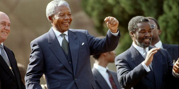 Nelson Mandela dances in front of the crowd at the Union Buildings after he was inaugurated as South...