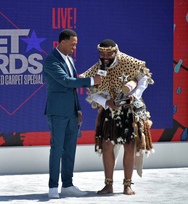 LOS ANGELES, CA - JUNE 24: Host Terrence J (L) presents the International Viewer's Choice award for Best...