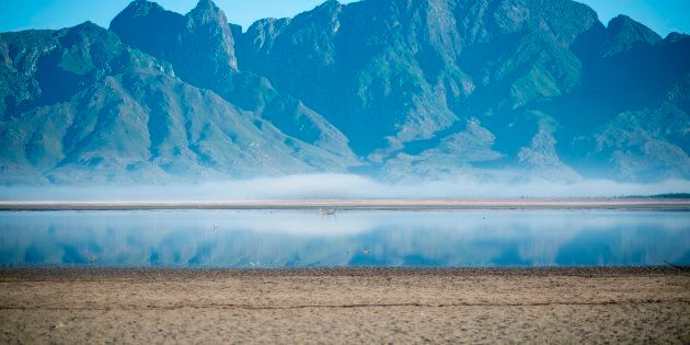 A picture taken on May 10, 2017 shows bare sand and a narrow body of water facing the sky at Theewaterskloof...