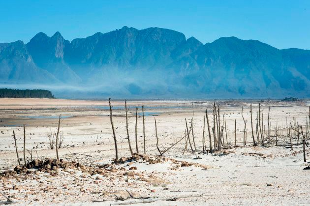A picture taken on May 10, 2017 shows bare sand and dried tree trunks standing out at Theewaterskloof...
