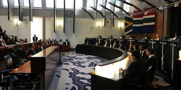 South African Chief justice Mogoeng Mogoeng (2nd from R top row) reads the ruling during the judgment...