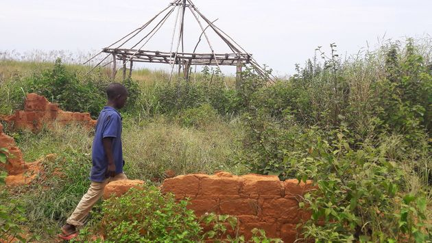 A boy walks past the ruins of the destroyed house of customary chief Kamuina Nsapu, whose death last...