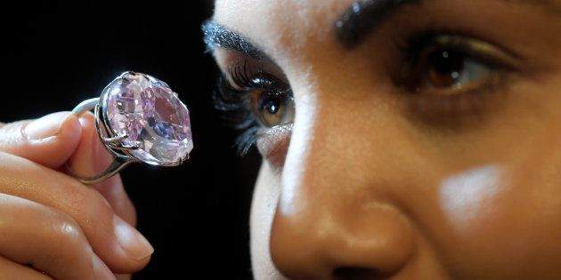 A model poses with a 59.60-carat mixed cut diamond known