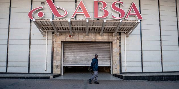 A security official stands at the shuttered entrance to the closed Absa Bank headquarters in Johannesburg...