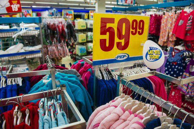 A rand price sign sits above rails of children's clothing for sale inside a PEP retail store, operated...