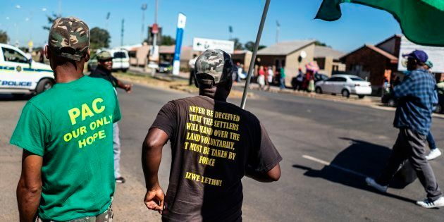 Pan African Congress (PAC) activists march as they commemorate the Sharpeville massacre anniversary at...
