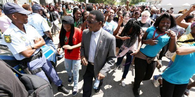 GRAHAMSTOWN, SOUTH AFRICA; OCTOBER 19: Rhodes University vice-chancellor Dr Sizwe Mabizela with students...
