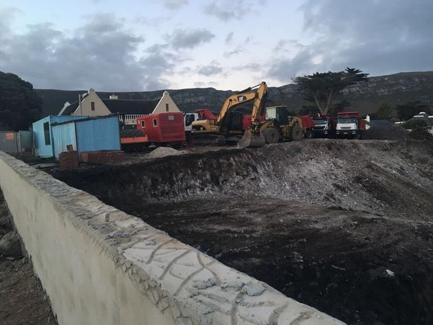 The site office and an excavator in the property in Hermanus where Jooste is buidling an new holiday