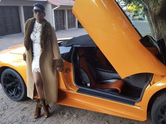 Khosi Madzonga posing next to a Lamborghini in one of the images that have since been removed from