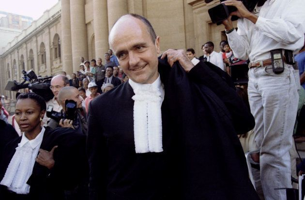 South African President Nelson Mandela's lawyer Wim Trengove smiles as he leaves the Rand Supreme Court...