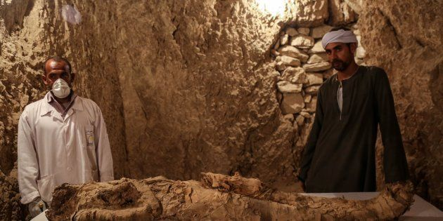 LUXOR, EGYPT - DECEMBER 09: Egyptian archaeologists are seen near an ancient mummified body that belongs...