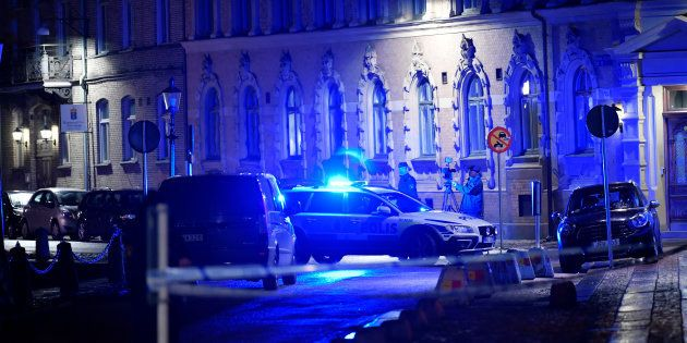 Police is seen at the site of an attack near a synagogue in Gothenburg, Sweden December 9,