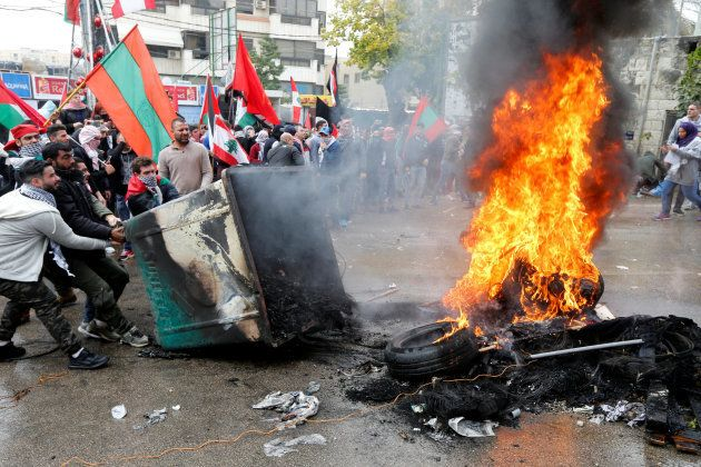 Protesters are seen near the U.S. embassy in Awkar, in Beirut, Lebanon December 10,