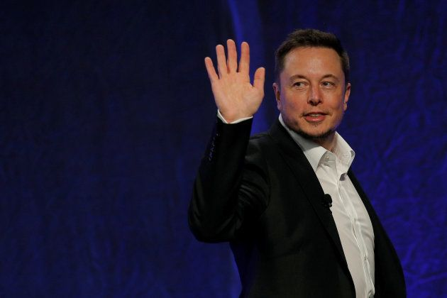 Tesla Motors CEO Elon Musk waves as he leaves the stage after speaking at the National Governors Association...