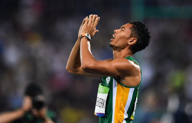 Wayde van Niekerk of South Africa celebrates winning the Men's 400m final with a world record time of...