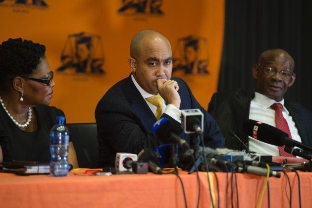 South African National Prosecuting Authority director Shaun Abrahams (C) gives a press briefing on October...