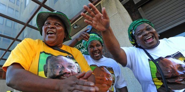ANC members show their support for party leader and South African President Cyril