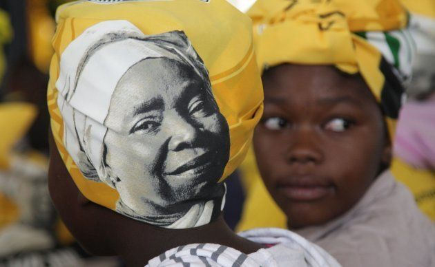 A woman is seen wearing a doek adorned with Dlamini-Zuma's likeness during a gathering on December 10,...