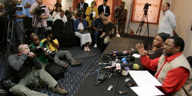ANC secretary-general Gwede Mantashe (R) addresses the media in Kempton Park, outside Johannesburg, on...