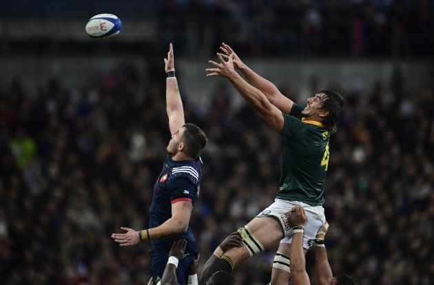 South Africa's lock and captain Eben Etzebeth (R) reaches for the ball in a line out during the friendly...