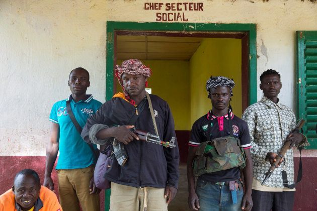 Members of the of the Anti-Balaka armed militia pose as they display their weapons in the in the town...