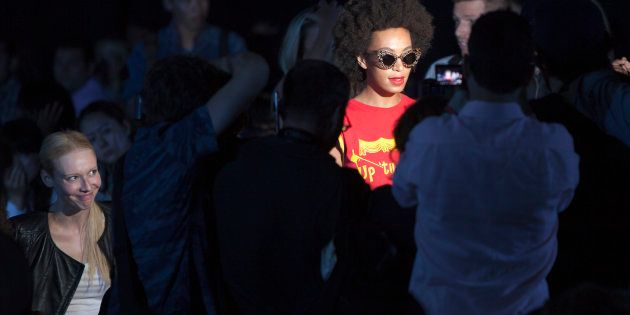 Solange Knowles (R) arrives for the Alexander Wang Spring/Summer 2014 collection during Fashion Week...